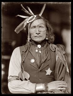 Iron White Man - one of two Sioux know to have this name. This man is thought to have been with Buffalo Bill's Wild West Show; his non-traditional dress in the photo would seem to bear that out. He was also thought to have participated in the Battle of the Little Big Horn against Custer, but that is not known for certain.