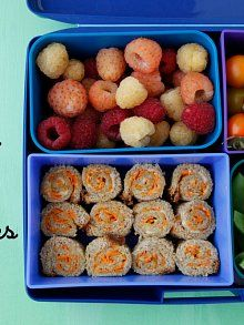 "Grated carrot and hummus ""sushis"" sandwich bites, snap peas, cherry tomatoes and mix of berries - Weelicious"