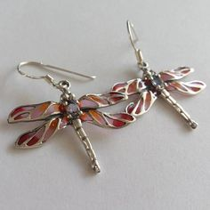 Stained Glass Dragonfly Earrings in Sterling Silver Libelula Violeta  Gorgeous look, the light goes through the stained glass, very feminine earrings, feel so light-minded and easy-going as a dragonfly. In addition, dragonfly is a symbol of immortality.  Sterling Silver 925, Stained Glass (Violet, Orange, Red), Zirconium Weight: 3,1 g Width: 2,8 cm (1.1 inches) Full length: 3,5 cm (1.38 inches)  Art.: M-38063  Made in Spain  Available also in green, here: https://www.etsy.com/l...