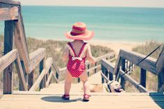 Love the red attire on this adorable little one getting ready for the beach.