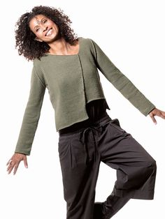 "This unusual cropped, asymmetrical silhouette is worked in simple stockinette. Skill level: Easy Shown in size Small   Sizes Directions are for women's size Small. Changes for sizes Medium, Large and X-Large are in parentheses.   Finished Measurements Bust – 40(44-48-52)"" Length – 21½(22-22½-23)"" from shoulder to lowest point."