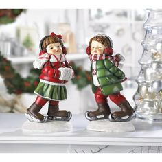 Holly & Noel Skating Figurines  $11.00  #homedecor #holdiays #christmasdecor.  They are waiting to be added to your Christmas decorations. Both of these cuties are made out of poly resin and they are painted so cute.
