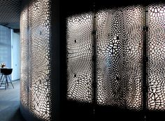Big Data Becomes Architecture in This CNC-Milled Screen Wall for IBM