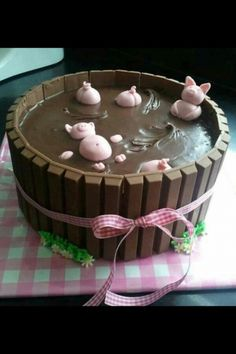 "If ever there was an easy to make cake, it has to be a kit-kat one. We have already seen a few unusual styles in my post ""Top 10 Kit Kat Cakes"" but this post is going to take things tha… Pigs In Mud Cake, Pig In Mud, Food Cakes, Cupcake Cakes, Torta Kit Kat, Kitkat Torte, Piggy Cake, 21st Cake, Cute Cakes"