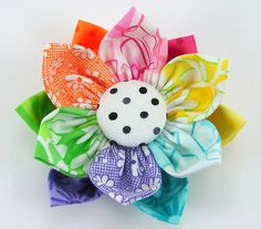 kanzashi flower...made a flower like this before...except with one pattern of fabric. Love how fun this one looks.