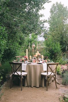 Romantic garden bohemian wedding inspiration with pink flowers, cascading eucalyptus, and gilded wedding decorations | Photography: Urban Safari Photography #bohowedding #bohemianwedding #gardenwedding #pinkwedding