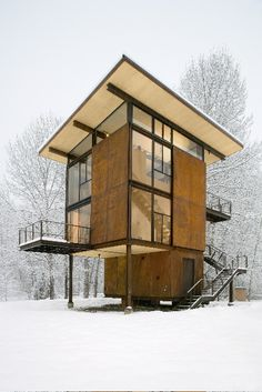 "This sweet 3-story ""cabin"" is somewhere in Washington - big steel shutters crank open or shut as needed."