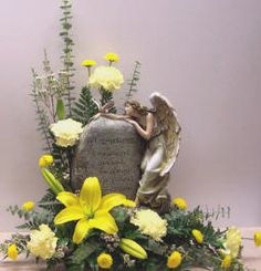 Custom Funeral Flower Designs | This beautiful Angel & stone statue is one our newest offerings. Click ...