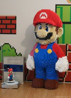 Ever wanted a giant LEGO model of Mario from Super Mario Bros? Well, Keith Brogan of the Luxology forums did, so he made one. Original Mario statue being s… Lego Mario, Lego Super Mario, Mario Bros., Lego Design, Deco Lego, 3d Scanner, Lego Sculptures, 8bit Art, Amazing Lego Creations