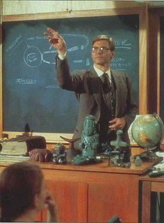 """Indiana Jones teaches class in the """"Raiders Of The Lost Ark""""(1981) This is how I see myself standing in front of desk gesticulating how awesome history can be if only they could see beyond the screen of their cell phones."""