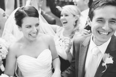 bride and groom, surrounded by their excited and smiling bridal party, laugh and smile  at their pema osel ling retreat center wedding in the santa cruz redwood mountains in corralitos, ca