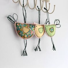 Spring Hanging Birdy Decoration. Made from cottons using a freehand machine embroidery technique, backed onto a quality wool fabric. The body measures 10cm x 6cm with those lovely legs taking it to approx 14cm.