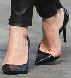 "Keri Russell added an interesting touch to the classic black pumps in an embossed pair of Saint Laurent ""Anja"" pumps"