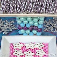 Create a kingdom of treats for a Frozen party! Yogurt-covered pretzels *POP* on a plate of pink gumballs. Special thanks to Crissy's Crafts for these creative Frozen party ideas!