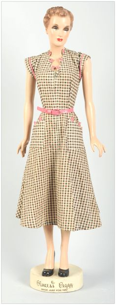 """March 30th Auction. 1930s """"Princess Peggy"""" Dresses Advertising Figure. Made of hard rubber composition. This exceptionally large counter display is in original condition. Dress is original to the display. #FiguralAdvertising #MorphyAuctions"""