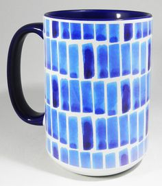 The Big Blue Tile Mug - Extra Large Mug with blue glazed finish on handle and interior. Simple tiled design. Very large mug. Designed and printed in Britain. A high quality ceramic mug which is both dishwasher and microwave proof. Height is 11.5cm, diameter 8.5 cm, with a capacity of 450 ml (15.8oz). From the Series 8 Patterns Range from Half a Donkey