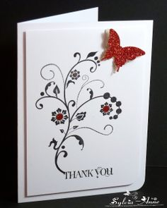 handmade thank you card from Poppy's Papercraft Patch ... flower flourish stamped in black ... red glimmer paper punched butterfly  and circle flower centers ... luv the elegant look .... popped up layer adds a touch of class ,,, great card!! ... Stampin' Up!