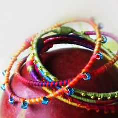 bangle bracelets using wire, embroidery floss, and beads