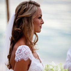 Amanda's hair was styled into a half updo with soft curls and a veil at the back.