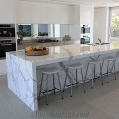 Interior, Elegant White Calacatta Marble Kitchen Island With White Min Bar Chairs Set And Bright White Modern Kitchen Set Design Ideas: How To choose Suitable Calacatta Marble for Beautiful Interior Kitchen Cabinets And Countertops, Granite Kitchen, White Kitchen Cabinets, Kitchen Flooring, Granite Countertops, Kitchen Worktops, Granite Tops, Shaker Cabinets, Kitchen Cupboard