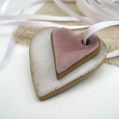 A new shoot for my ceramic heart decorations. Handmade in stoneware clay and glazed in white and pink. These hearts are strung together on white ribbon. Fimo Clay, Polymer Clay Crafts, Ceramics Projects, Clay Projects, Ceramic Jewelry, Clay Jewelry, Cerámica Ideas, Salt Dough Crafts, Christmas Clay