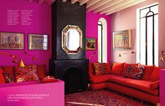 I've always loved hot pink and red together, and this room displays this combination brilliantly.  Source: Art & Décoration.