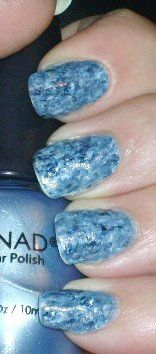 User said: I painted my nails with one coat of a matte pastel blue polish, let it dry, then applied small dots of the same pastel blue, a medium blue with shimmer and a dark blue with shimmer and with a toothpick I swirled the colors around until I got the look I wanted, and then applied tiny dots of silver polish and dark blue polish and swirled it around, adding some more dots of polish on certain areas that I thought needed more, once I got the look I wanted I applied 2 coats of top coat…
