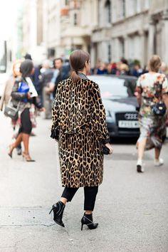 Miroslava Duma in a leopard-print coat + black trousers + black ankle boots