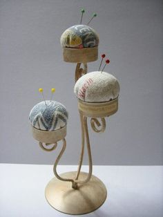 Make one of these with candle holder. Love the 'make-do' ideas for pincushions.
