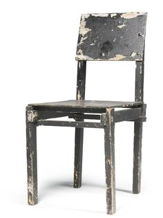 Gerrit Thomas Rietveld, 1888-1964 MILITARY CHAIR black painted wood, revealing the original grey paint in places 88 by 40.5 by 53cm., 34 1/2...