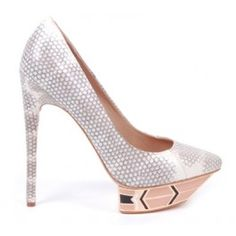 Gorgeous! 18K gold plated, hand enameled platforms and the finest Italian leathers all combined in one fabulous pump! Ivy Kirzhner is a genius. Get these and more styles at kokopalenki.com. Search using sku #42568