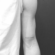 Minimalist coordinates on the left bicep. Tattoo artist: Jon Boy · Jonathan Valena