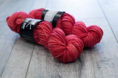 Worsted weight merino yarn. 100% Superwash Merino. Sweater weight yarn. Medium Weight yarn. Red Riding Hood. Tonal Red. Semi solid yarn by blackcatcustomyarn on Etsy https://www.etsy.com/listing/551506296/worsted-weight-merino-yarn-100-superwash