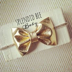 Gold faux leather bow on metallic sparkly baby girl headband