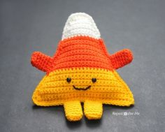 crochet candy corn pattern - pillow by @repeatcrafterme