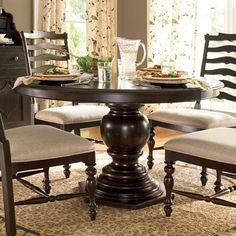 Weathered pedestal dining table with a hexagon-shaped base. Product: Dining tableConstruction Material: Wood