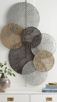 A stunning work that seems to float airily across your wall the Adele Metal Wall Art is formed of laser-cut metal disks welded together forming a striking display. Each disk has a lacy delicately textured cut-out design inspired by natural elements. Metal Wall Art Decor, Metal Tree Wall Art, Flower Wall Decor, Modern Metal Wall Art, Gold Metal Wall Art, Silver Wall Decor, Metallic Decor, Feather Wall Decor, Big Wall Art
