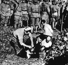 Chinese civilians prepared to be buried alive by Japanese soldiers, Nanjing, China, Dec 1937-Jan 1938