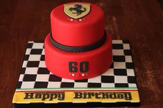 Ferrari lover turning Checkered flag board, Ferrari red cake with hand cut Ferrari logo plaque, and birthday message. Bottom tier is vanilla cake with vanilla buttercream, top tier is chocolate cake with chocolate buttercream. Ferrari Cake, Ferrari Party, Ferrari Logo, Chocolate Buttercream, Vanilla Buttercream, Vanilla Cake, Chocolate Cake, Just Cakes, Cakes And More