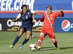 Sydney Leroux and Russia's Ksenia Tsybutovich, Feb. 8, 2014, in Boca Raton, Fla. The United States won 7-0. (Alan Diaz/AP)