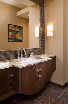 The Awesome Web One of the guest suites has a floating vanity which is contemporary and makes the
