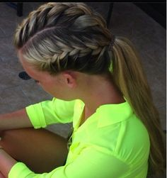 Sporty hairdo... a french braid on both sides and the top pulled into a ponytail!!