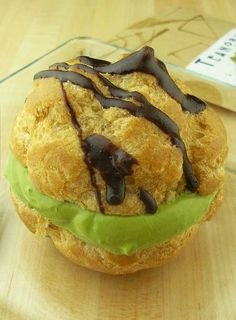 Recipe for Matcha Green Tea Cream Puffs  •1/2 cup white sugar  •5 tablespoons all-purpose flour  •1 pinch sea salt  •1 tablespoons matcha powder*  •2 cups non-fat milk  •2 egg yolks, beaten  •1 teaspoon vanilla extract  •1/2 cup shortening  •1 cup green tea, brewed  •1 cup all-purpose flour  •1 pinch sea salt  •4 eggs