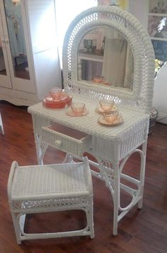 I have this exact white wicker vanity and stool in my basement.  I'd love to repaint it a fun color for Hannah's room.