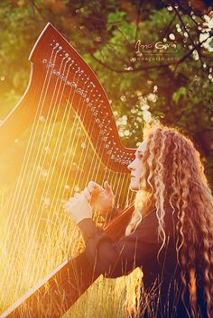 Harpist Photography. Next time my aunt comes to visit she's taking a photo of me like this. So beautiful.