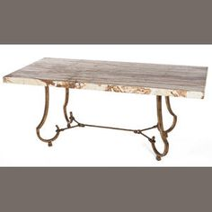 A Maison Ramsay gilded wrought-iron and onyx dining table circa 1940  circa 1940  height 30in (76cm); length 72in (183.5cm); depth 33 3/4in (86cm)  Estimate: US$ 7,000 - 10,000  gbp4,400 - 6,300  €5,500 - 7,800
