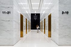 Gold mirrored lift reveals by Fogarty Finger » 437 Madison Avenue