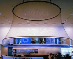 Stainless steel ferrule rope mesh is installed in the high position of a restaurant.
