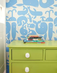"""Whale of a Wallpaper:     Little Whales from Walnut Wallpaper is a buoyant backdrop for a dresser Ewart painted so that """"every room has at least a peek of green."""""""