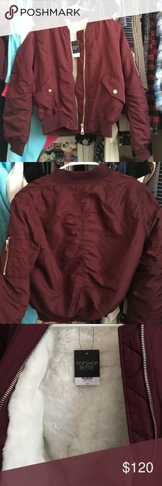 Topshop Petite Burgundy Bomber Jacket Burgundy Bomber Jacket EUR36 US4 UK8   NEVER worn with tags still attached. Silver & Gold zipper detailing. Left sleeve gold zipper pocket. Two lower front pockets. Faux Fur inside.   Price below or best offer given. Topshop PETITE Jackets & Coats Puffers